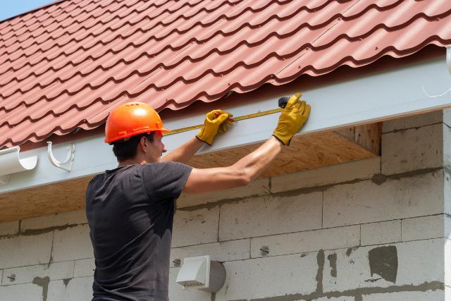Gutter installation by worker